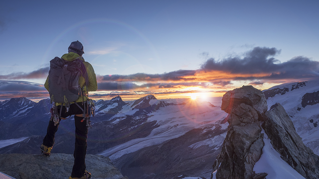 Climber_on_a_peak_watching_sunrise_GettyImages-667864207_super.png